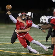 Neptune quarterback Nino Bua gets tackled mid-throw by Toms River East Frank Giannetti. Toms River East football squeaks by Neptune 14-13 to stay unbeaten on October 11, 2019 in Neptune, NJ.