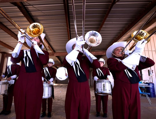 Ryan Sanford, James Bogle and Koda Miller practice in the livestock barn at Wylie High School with the rest of the Hawley High School Bearcat Band Saturday. The band joined more than 20 others for the Big Country Marching Festival.
