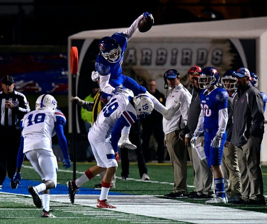 Cougars running back Noah Garcia is lifted into the air as he is knocked out of bounds by Dons defensive back Noel Marquez during Friday's game at Shotwell Stadium between Cooper and Amarillo Palo Duro Oct. 11, 2019. Final score was 42-6, Cooper.