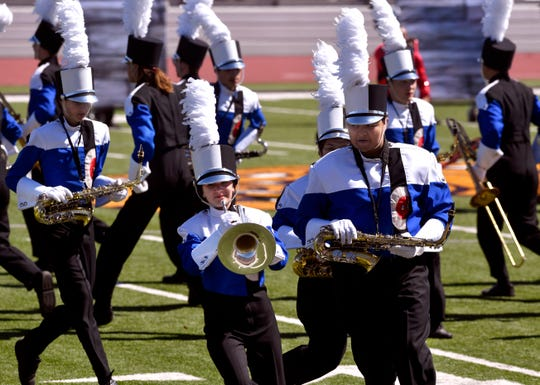 Cooper High School band members perform during Saturday's Big Country Marching Festival at Wylie ISD's Bulldog Stadium. More than 20 bands competed.