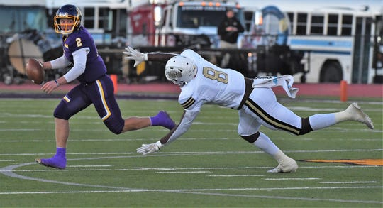 Wylie quarterback Balin Valentine rolls out against Wichita Falls Rider. Valentine completed all but two of his passes for 155 yards and two touchdowns while rushing for another score in the Bulldogs 28-6 victory to earn ARN Local Player of the Week honors.