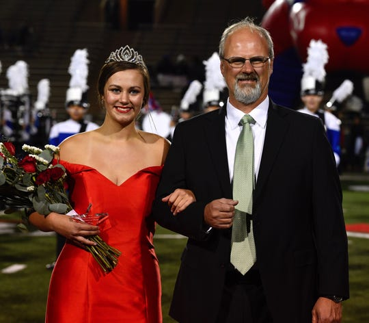 Ellis McMillon, escorted by her father, Jeff, is all smiles after being named 2019 homecoming queen at Cooper High School.