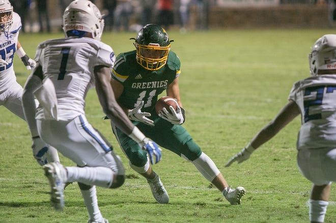 Christ School's Cade Mintz rus the ball against Charlotte Christian on Oct. 11, 2019. Charlotte Christian took the win with a final score of 28-27.