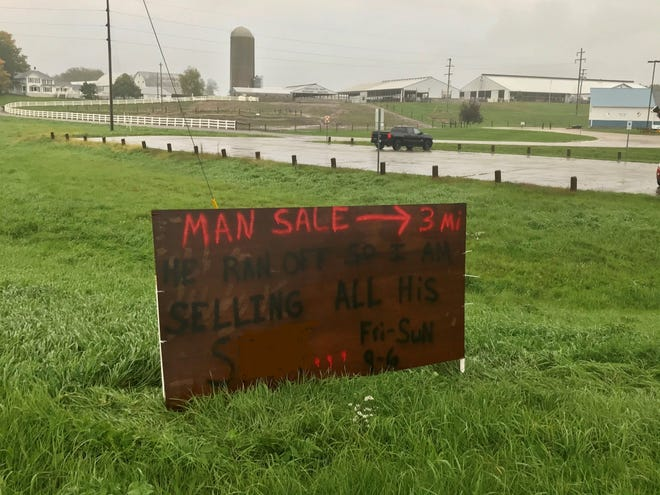 The man sale sign at the intersection of M-66 and M-79 in Nashville (with one word edited out).
