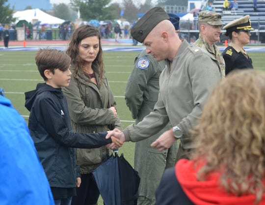 Trey Myers, a 13-year-old boy who recently gained widespread attention for his act of patriotism, was honored prior to Harper Creek's Friday football game by various state and county military officials.