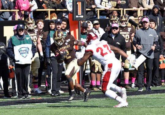Western Michigan running back LeVante Bellamy (2) tries to slip past Miami (Ohio) linebacker Kobe Burse on Saturday, Oct. 12, 2019 at Waldo Stadium in Kalamazoo, Michigan.