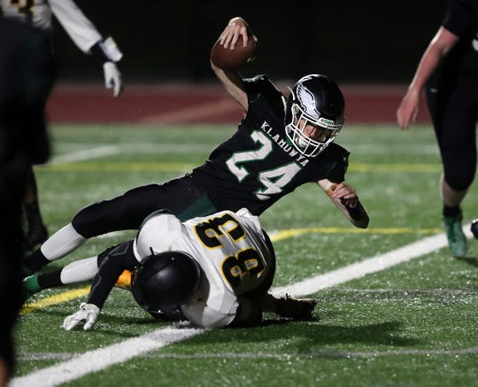 Klahowya's Nick Lewis (24) bowls over Vashon's Ryan Nelson (33) for a touchdown in the second quarter on Friday, Oct. 11, 2019.