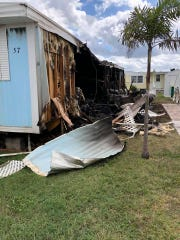 This manufactured home in the Pelican Bay neighborhood was heavily damaged by fire Saturday in Micco.