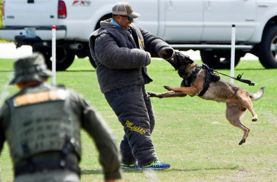 20 military and police K9 units from all over the world compete in the Second Annual Space Coast Police K9 Competition at Dick Blake Stadium in Cocoa.