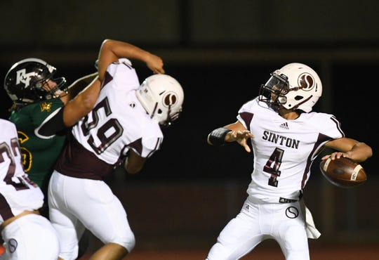 Sinton's Rene Galvan, right, prepares to throw a pass at the game against Rockport-Fulton, Friday, Oct. 11, 2019, at Rockport. Rockport-Fulton won, 41-27.