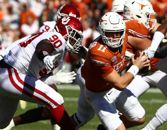 Oct 12, 2019; Dallas, TX, USA; Texas Longhorns quarterback Sam Ehlinger (11) is sacked in the first quarter by Oklahoma Sooners nose guard Neville Galimor (90) at Cotton Bowl. Mandatory Credit: Matthew Emmons-USA TODAY Sports