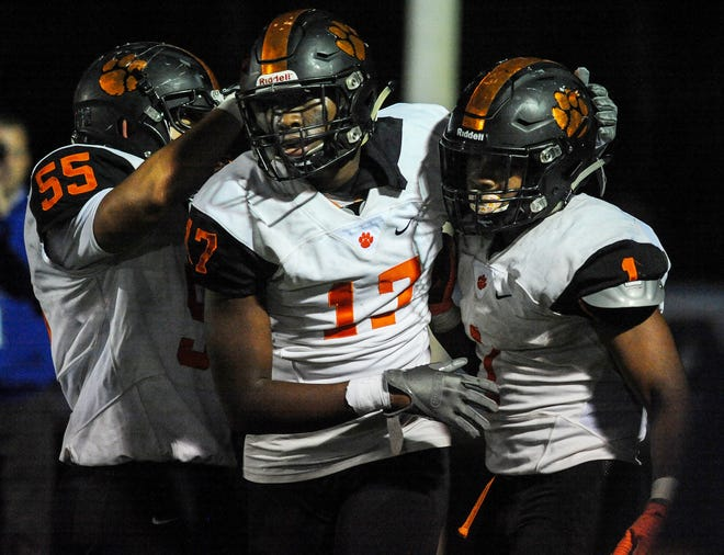 Woodrow Wilson's players celebrate in the end zone during Friday's football game against Shawnee at Shawnee High School, Oct. 11, 2019.