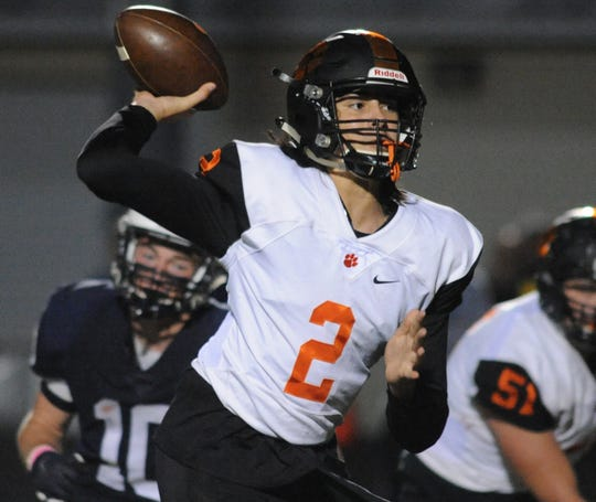 Woodrow Wilson's Devin Kargman throws a pass during Friday's football game against Shawnee at Shawnee High School, Oct. 11, 2019.