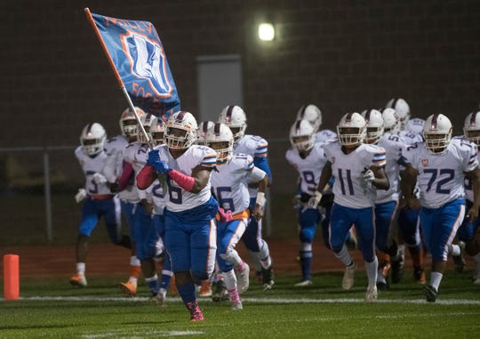 The Millville High School football team enters the field prior to the football game between Millville and Timber Creek, played at Timber Creek High School on Friday, October 11, 2019.