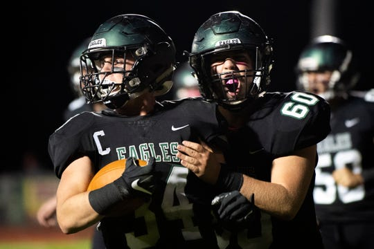 West Deptford's Gavin Shields (34) and Michael Griffith (60) celebrate a touchdown against Haddonfield Friday, Oct. 11, 2019 in West Deptford.