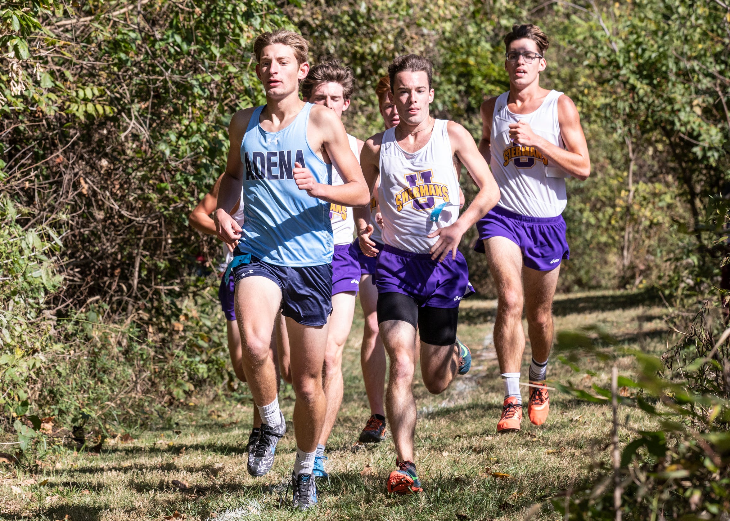 Adena's Noah Kanniard leads Unioto pack runners Eric Hacker, Robert Immell, and Clayton Lynch during the  2019 Scioto Valley Conference Cross Country Championships race at Southeastern High School.
