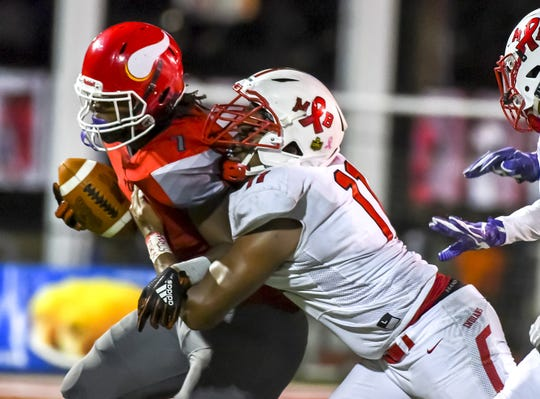 Brandon Smith (11) of the Fairfield Indians tackles Thomas Boyd (7) of the Princeton Vikings at the Skyline Chili Crosstown Showdown on Friday, October 11, 2019, Mancuso Field at Princeton High School