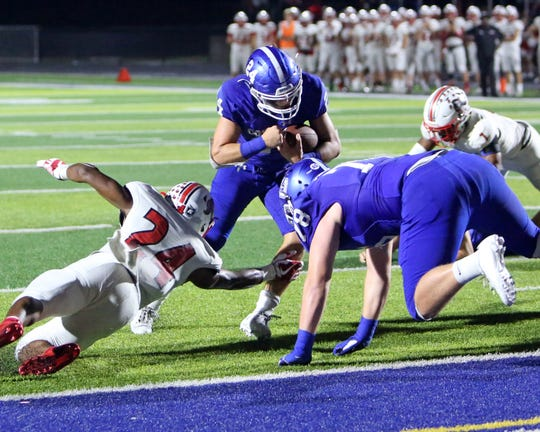 Covington Catholic's Daniel Felix runs in for a touchdown in the game between the La Salle and Covington Catholic High School Oct. 11, 2019.