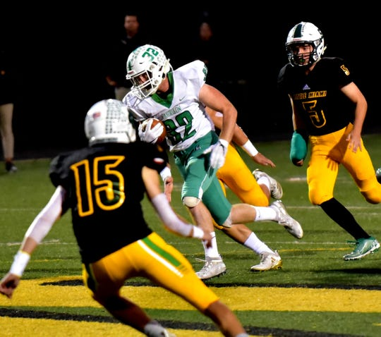 Harrison's Cam Hering (32) breaks through the Little Miami defense on his way to a Wildcats' touchdown, Oct. 11, 2019.