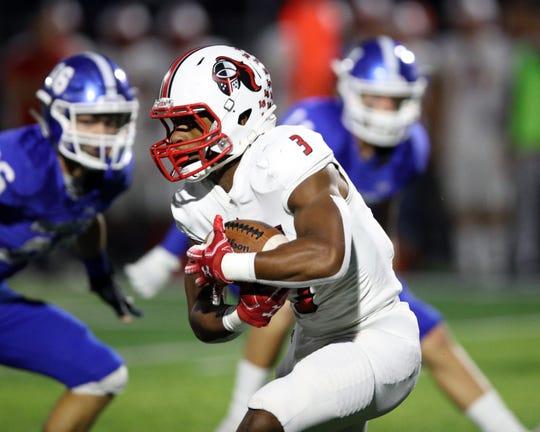La Salle running back Gi'Bran Payne runs the ball in the game with Covington Catholic High School Oct. 11, 2019.