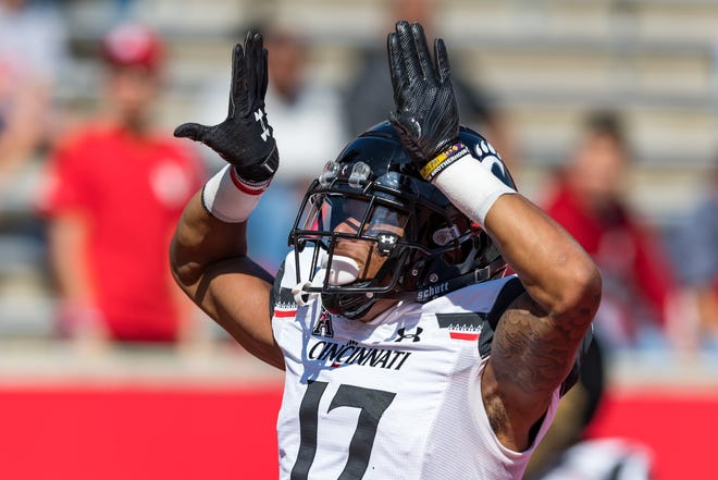 Oct 12, 2019; Houston, TX, USA;  Cincinnati Bearcats wide receiver Rashad Medaris (17) celebrates after his touchdown in the first quarter of the game between Houston Cougars and Cincinnati Bearcats at TDECU Stadium. Mandatory Credit: Maria Lysaker-USA TODAY Sports