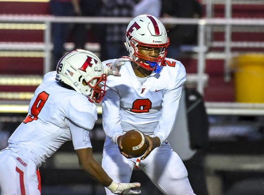 Sawiaha Ellis (2) of the Fairfield Indians hands off the ball to JuTahn McClain (9) against the Princeton Vikings at the Skyline Chili Crosstown Showdown on Friday, October 11, 2019, Mancuso Field at Princeton High School