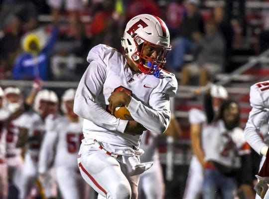 Fairfield quarterback Sawiaha Ellis protects the ball against the Princeton Vikings at the Skyline Chili Crosstown Showdown on Friday, October 11, 2019, Mancuso Field at Princeton High School