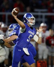 Covington Catholic quarterback Caleb Jacob attempts a pass in the game with La Salle Oct. 11, 2019.