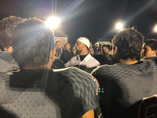 Bernards football coach Jon Simoneau talks to his players after the Mountaineers dealt Delaware Valley its first loss on Friday, Oct. 11, 2019.