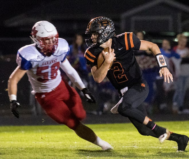 Ridgewood quarterback Gabe Tingle runs with the ball during a 46-7 win against Garaway in 2019. Tingle returns for his junior season after earning All-Ohio honors as a sophomore.