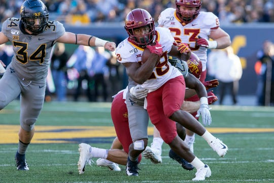 Iowa State running back Breece Hall (28) escape the tackle of West Virginia safety Tykee Smith (23) during the first half of an NCAA college football game Saturday, Oct. 12, 2019, in Morgantown, W.Va.