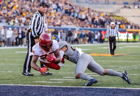 Iowa State running back Breece Hall (28) dives for a touchdown against West Virginia during their game on Oct. 12, 2019, in Morgantown, West Virginia.