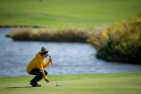 Logan Barnes of Southeast Polk lines up his putt on the 18th hole during the boys fall state golf tournament at the Tournament Club of Iowa on Saturday, Oct. 12, 2019 in Polk City.