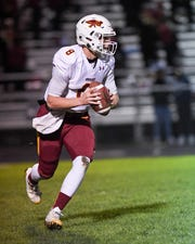 Ankeny quarterback Jase Bauer (8) scrambles as he looks for a receiver on Friday, Oct. 11, 2019 during a game between the Ankeny Hawks and the Lincoln Railsplitters.