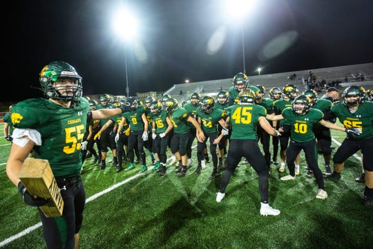 Cedar Rapids Kennedy's Nolan Jacobs (55) celebrates with teammates after a Class 4A varsity football game against Bettendorf, Friday, Oct., 11, 2019, at Kingston Stadium in Cedar Rapids, Iowa.