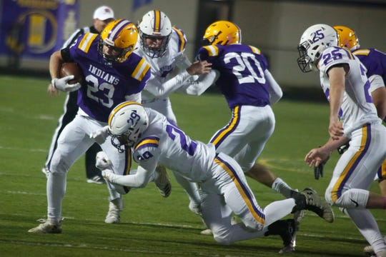 Indianola sophomore running back Kael Kolarik tries to pull free of Johnston junior linebacker Aidan Moore. Indianola hosted Johnston in a key district game on Oct. 11.
