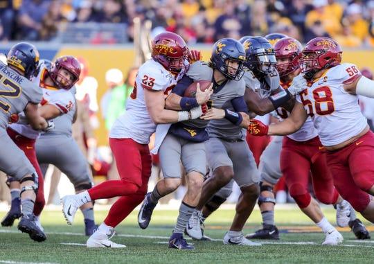 Iowa State linebacker Mike Rose (23) sacks West Virginia quarterback Jack Allison  on Saturday.