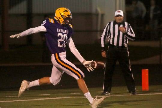 Indianola senior Blake Kennedy punts from his own endzone. Indianola hosted Johnston in a key district game on Oct. 11.