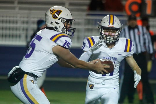 Johnston sophomore quarterback Noah Storts hands the ball to senior runningback Jordan Rusch. Indianola hosted Johnston in a key district game on Oct. 11.