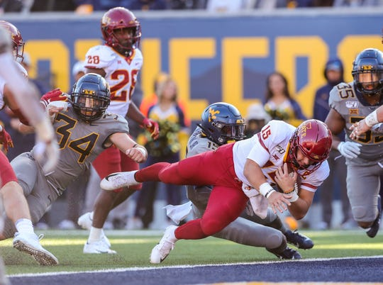 Oct 12, 2019; Morgantown, WV, USA; Iowa State Cyclones quarterback Brock Purdy (15) dives for a touchdown during the second quarter against the West Virginia Mountaineers at Mountaineer Field at Milan Puskar Stadium. Mandatory Credit: