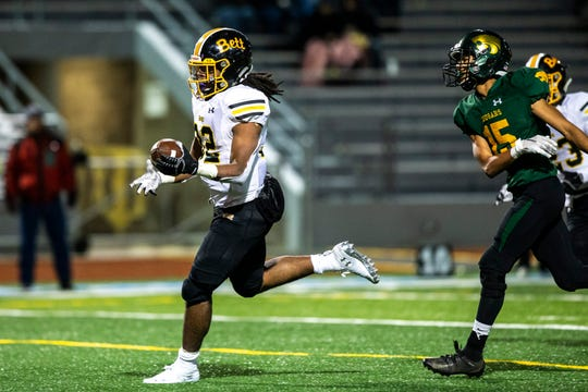 Bettendorf's Harrison Bey-Buie (32) scores a touchdown during a Class 4A varsity football game, Friday, Oct., 11, 2019, at Kingston Stadium in Cedar Rapids, Iowa.