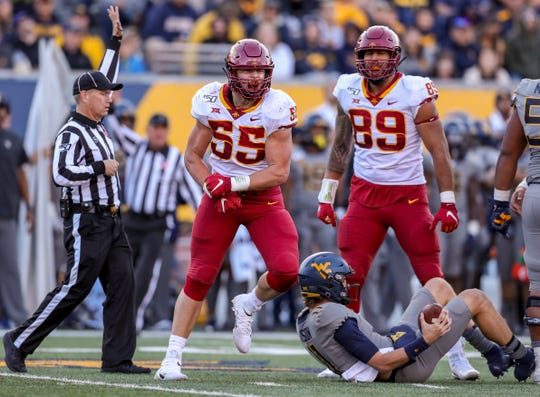 Oct 12, 2019; Morgantown, WV, USA; Iowa State Cyclones defensive end Zach Petersen (55) celebrates after tackling West Virginia Mountaineers quarterback Jack Allison (11) for a sack during the third quarter at Mountaineer Field at Milan Puskar Stadium.