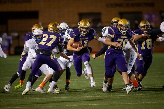 Norwalk's Zach Marker (11) rushes during their football game on Friday, Oct. 11, 2019 in Norwalk. Norwalk takes a 24-3 lead into halftime.