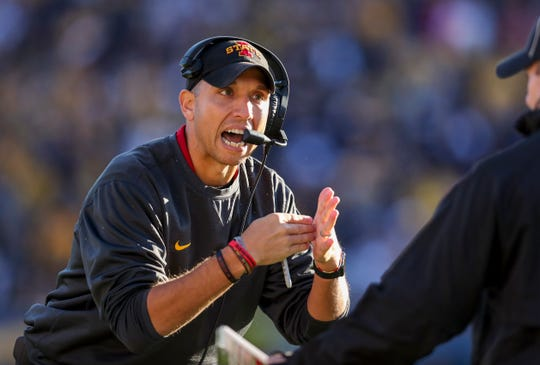 Oct 12, 2019; Morgantown, WV, USA; Iowa State Cyclones head coach Matt Campbell attempts to call a timeout during the second quarter against the West Virginia Mountaineers at Mountaineer Field at Milan Puskar Stadium.