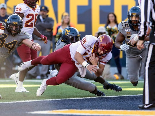 Iowa State quarterback Brock Purdy (15) runs for a touchdown during the first half of an NCAA college football game Saturday against West Virginia, in Morgantown, W.Va.