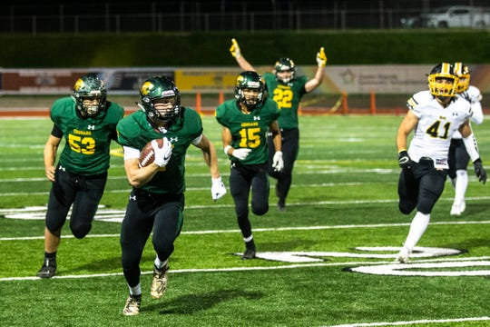 Cedar Rapids Kennedy's Brandtley Koske (7) scores a tourchdown during a Class 4A varsity football game, Friday, Oct., 11, 2019, at Kingston Stadium in Cedar Rapids, Iowa.