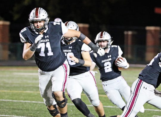 Ankeny Centennial senior offensive lineman and ISU commit Brady Petersen (71) clears a path for the running back as the No. 10 Fort Dodge Dodgers battle against the No. 6 Ankeny Centennial Jaguars in the first half of play during the Class 4A-District 2 game on Friday, October 11, 2019 at Ankeny Stadium.