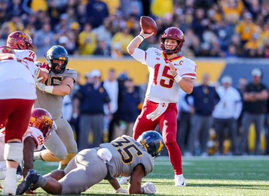 Oct 12, 2019; Morgantown, WV, USA; Iowa State Cyclones quarterback Brock Purdy (15) throws a pass during the first quarter against the West Virginia Mountaineers at Mountaineer Field at Milan Puskar Stadium.