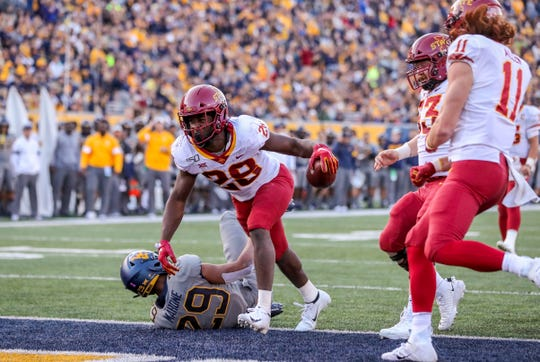 Oct 12, 2019; Morgantown, WV, USA; Iowa State Cyclones running back Breece Hall (28) scores a touchdown during the third quarter against the West Virginia Mountaineers at Mountaineer Field at Milan Puskar Stadium.