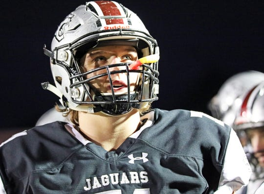 Ankeny Centennial senior offensive lineman and ISU commit Brady Petersen (71) checks the scoreboard as the No. 10 Fort Dodge Dodgers battle against the No. 6 Ankeny Centennial Jaguars in the first half of play during the Class 4A-District 2 game on Friday, October 11, 2019 at Ankeny Stadium.